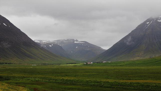 Image of mountains and fields in Iceland with overcast sky